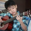 Guitar lesson for kids by JJ Piano Forte