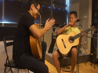 Guitar Lessons by Atelier Music Academy