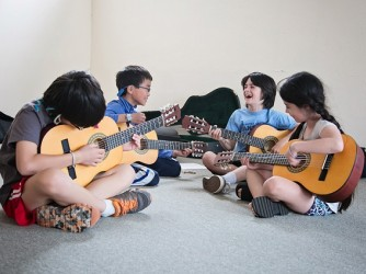Guitar lessons by Ouch Music Academy Sdn Bhd